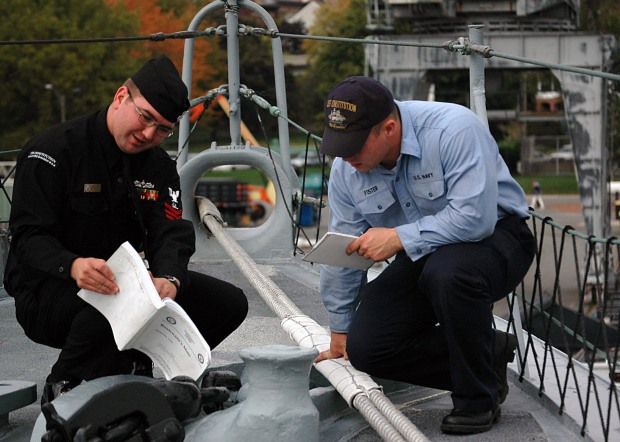 071023-N-1060K-019 BOSTON (Oct. 23, 2007) - BoatswainÕs Mate 1st Class Aaron Haney and Seaman Dustin Foster, both stationed aboard USS Constitution, review the boatswainÕs mate training material. The decommissioned Cassin Young, a World War II Fletcher-class destroyer moored near ÒOld Ironsides,Ó provided Haney an environment to help USS Constitution Sailors such as Foster, prepare for the March rating exams. U.S. Navy photo by Mass Communication Specialist Seaman Anna L. Kiner (RELEASED)