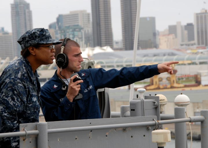 100609-N-1060K-069 SAN DIEGO (June 9, 2010) Quarter Master 3rd Class Jake King, right, operates a sound-powered phone as he trains Quarter Master Seaman Rachel Tolliver on the signal bridge of the amphibious assault ship USS Boxer (LHD 4) during sea trials. Boxer is conducting its first underway period after a nine-month dry dock planned maintenance availability. (U.S. Navy photo by Mass Communication Specialist 3rd Class Anna L. Kiner/Released)