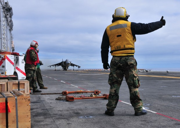 110224-N-1060K-011 PACIFIC OCEAN (Feb. 24, 2011) Aviation BoatswainÕs Mate 3rd Class Danrey White signals an AV8-B Harrier for take off aboard the amphibious assault ship USS Boxer (LHD 4). Boxer and the 13th Marine Expeditionary Unit (13th MEU) are underway for a scheduled deployment to the western Pacific region. (U.S. Navy photo by Mass Communication Specialist 3rd Class Anna Kiner/Released)