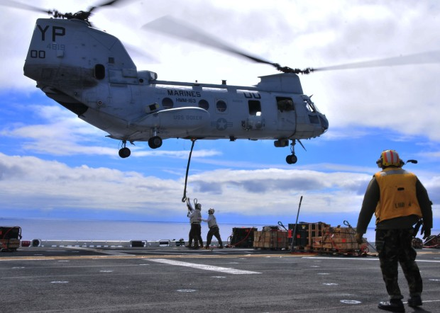 110224-N-1060K-109 PACIFIC OCEAN (Feb. 24, 2011) Combat Cargo Marines assigned to the amphibious assault ship USS Boxer (LHD 4) load ordnance onto a CH-46 Sea Knight helicopter during an ordnance transfer. Boxer and the 13th Marine Expeditionary Unit (13th MEU) are underway for a scheduled deployment to the western Pacific region. (U.S. Navy photo by Mass Communication Specialist 3rd Class Anna Kiner/Released)