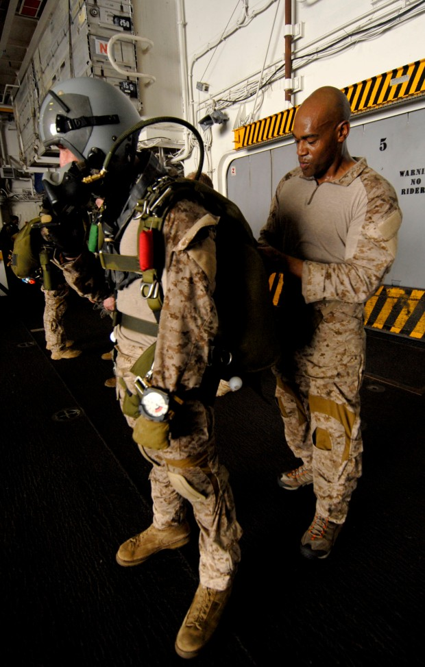 110625-N-DB458-015 GULF OF ADEN (June 25, 2011) Marine Master Sgt. Darwin White, right, assigned to the 13th Marine Expeditionary Unit (13th MEU), inspects the parachute equipment of another Marine in preparation for a routine parachute training evolution in the hangar bay aboard the amphibious assault ship USS Boxer (LHD 4). Boxer and the embarked 13th MEU are underway supporting maritime security operations and theater security cooperation efforts in the U.S. 5th Fleet area of responsibility. (U.S. Navy photo by Mass Communication Specialist 3rd Class Anna Kiner/Released)