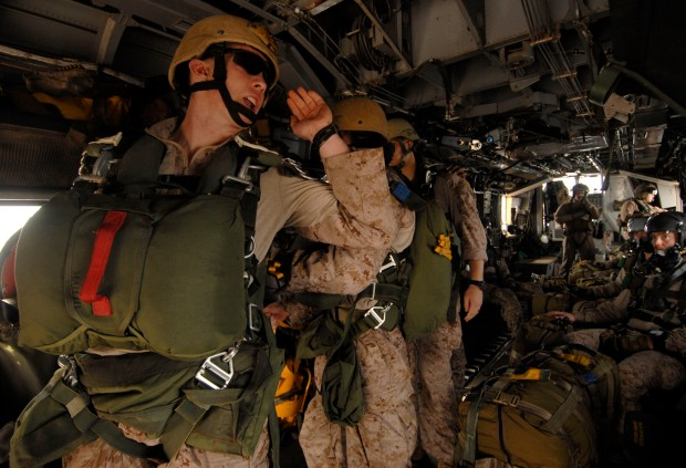 110625-N-DB458-088 GULF OF ADEN (June 25, 2011) Marines assigned to the 13th Marine Expeditionary Unit (13th MEU) prepare to jump from an H-53 Sea Stallion helicopter assigned to the Evil Eyes of Marine Medium Helicopter Squadron (HMM) 163 during a routine parachute training evolution. The 13th MEU is embarked aboard the amphibious assault ship USS Boxer (LHD 4) and is underway supporting maritime security operations and theater security cooperation efforts in the U.S. 5th Fleet area of responsibility. (U.S. Navy photo by Mass Communication Specialist 3rd Class Anna Kiner/Released)