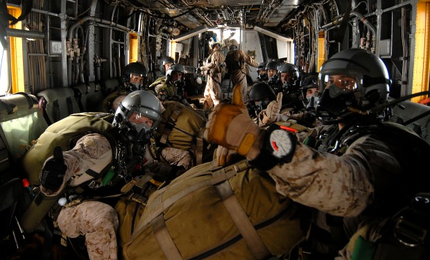 110625-N-DB458-195 GULF OF ADEN (June 25, 2011) Marines assigned to the 13th Marine Expeditionary Unit (13th MEU) indicate to their team leader that they are on air as they are transported to their drop point in an H-53 Sea Stallion helicopter assigned to the Evil Eyes of Marine Medium Helicopter Squadron (HMM) 163 during a routine sky diving evolution. The 13th MEU is embarked aboard the amphibious assault ship USS Boxer (LHD 4) and is underway supporting maritime security operations and theater security cooperation efforts in the U.S. 5th Fleet area of responsibility. (U.S. Navy photo by Mass Communication Specialist 3rd Class Anna Kiner/Released)